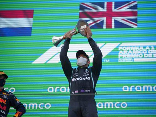 Lewis Hamilton celebrates on the podium after winning the Spanish Grand Prix (Emilio Morenatti/AP)