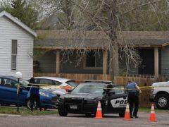 A Colorado Springs police officer at the scene (Jerilee Bennett/The Colorado Springs Gazette via AP)