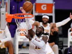 Los Angeles Lakers centre Montrezl Harrell dunks during the second half of his side's win over the Phoenix Suns (Marcio Jose Sanchez/AP)