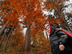 A child wears a vampire mask while walking in the courtyard of Bran Castle in Bran, Romania (Vadim Ghirda/AP)