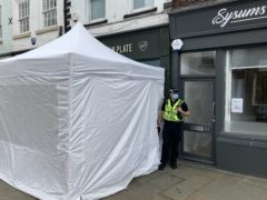 A police tent outside The Clean Plate cafe in Southgate Street, Gloucester (Rod Minchin/PA)