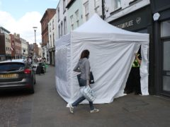 A police tent outside the Clean Plate cafe in Southgate Street, Gloucester (David Davies/PA)