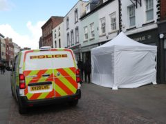 A police tent outside The Clean Plate cafe in Southgate Street, Gloucester (PA)