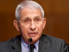 Anthony Fauci said Covid-19 had 'shown a bright light on our own society's failings' (Greg Nash/Pool via AP)