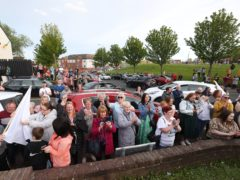 Supporters and family members watch as Briege Voyle, daughter of victim Joan Connolly, releases doves in the Ballymurphy area (Liam McBurney/PA)