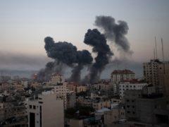Smoke rises after Israeli airstrikes on Gaza City (AP)