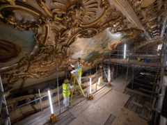 Specialist conservators working on the ornate ceiling during the restoration of the Blackpool Tower Ballroom (Oli Scarff/Blackpool tower/PA)