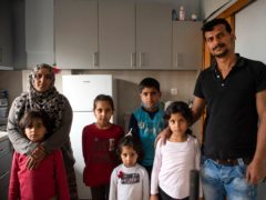 Abdul Salam Al Khawien and his wife Kariman with their children at their apartment in Thessaloniki, Greece (Giannis Papanikos/AP)