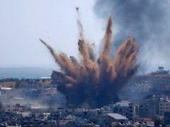 Smoke rises following Israeli air strikes on a building in Gaza City (Hatem Moussa/AP)