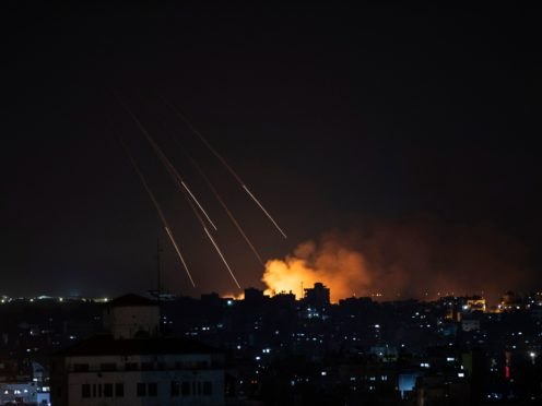 Smoke rises following Israeli missile strikes on Gaza City (Khalil Hamra/AP)