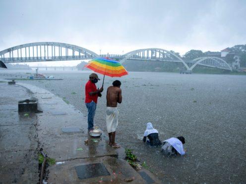 Heavy rain in Kochi, Kerala state, as Cyclone Tauktae approaches (RS Iyer/AP)