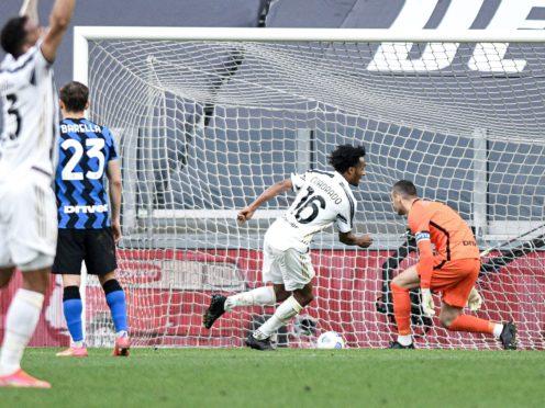 Juan Cuadrado kept his cool from the penalty spot to secure a late win (Piero Cruciatti/LaPresse via AP/Press Association Images)