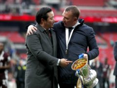 Leicester owner Khun Top (left) and manager Brendan Rodgers with the FA Cup at Wembley (Matthew Childs/PA)