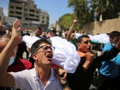 Mourners carry the bodies of Palestinians killed in the airstrikes overnight (Abdel Kareem Hana/AP)