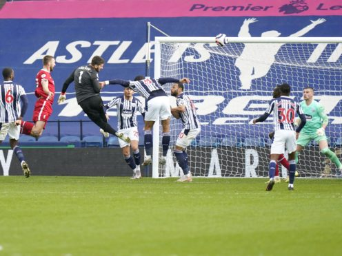 Liverpool goalkeeper Alisson scores a dramatic late winner (Tim Keeton/PA)