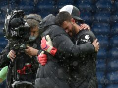 Liverpool goalkeeper Alisson embraces manager Jurgen Klopp at the Hawthorns (Rui Vieira/PA)