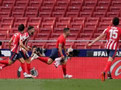 Luis Suarez celebrates after scoring a late winner (Manu Fernandez/AP)