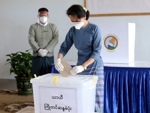 Aung San Suu Kyi casts her ballot in last year's election (AP/Aung Shine Oo, File)