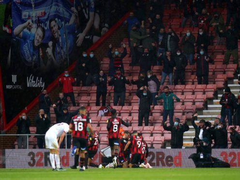 Bournemouth players celebrate in front of their fans (Adam Davy/PA).