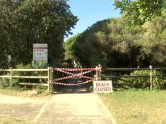 A beach closed sign in Tuncurry, Australia (Australian Broadcasting Corporation via AP)