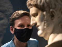 Project curator Francesca Bologna inspects a marble bust of Nero (Andrew Matthews/PA)