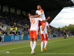Ellis Simms celebrates scoring Blackpool's third (Nigel French/PA)