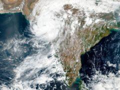 Cyclone Tauktae approaching India's western coast (Nasa/AP)