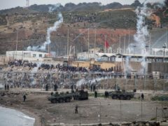 Spanish army and Guardia Civil officers take positions next to the border of Morocco and Spain, at the Spanish enclave of Ceuta (Javier Fergo/AP)