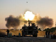 An Israeli artillery unit fires shells towards targets in the Gaza Strip (Tsafrir Abayov/AP)