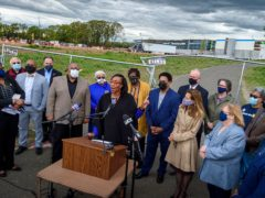 Local politicians and equal rights campaigners gather outside the warehouse where the nooses have been found (Mark Mirko/Hartford Courant via AP)