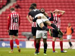 Lincoln celebrate their 3-2 aggregate victory over Sunderland (Owen Humphreys/PA)