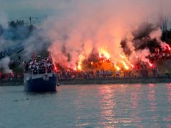 Red Star Belgrade fans celebrate after their team won the Serbian football league title (Darko Vojinovic/AP)