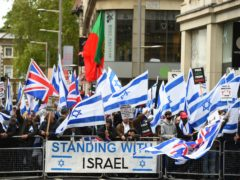 People take part in a pro-Israel rally adjacent to the Israeli embassy in Kensington High Street (Kirsty O'Connor/PA)