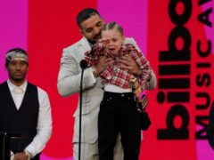 Drake was joined by three-year-old son Adonis as he was named artist of the decade at the Billboard Music Awards (Chris Pizzello/AP)