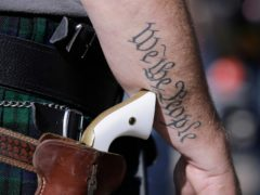 A supporter of open carry gun laws seen at a rally in Austin. Texas legislators have given final approval to allowing people carry handguns without a licence (Eric Gay/AP)
