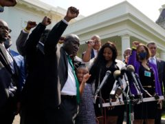 Lawyer Benjamin Crump, George Floyd's daughter Gianna, her mother Roxie Washington and others talk with reporters after meeting President Joe Biden at the White House (Evan Vucci/AP)