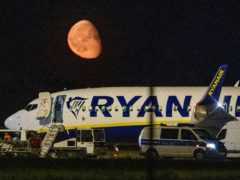 Federal police inspect a Ryanair aircraft after the unscheduled landing of the plane at the Berlin International Airport in Schoenefeld near Berlin, Germany (Christophe Gateau/dpa via AP)