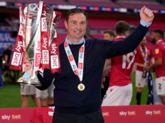 Morecambe manager Derek Adams refused to commit his future to the club after they reached the third tier of English Football for the first time in their history (John Walton/PA)