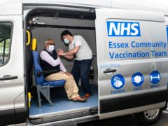 Jahirur Rahmn, aged 62, from Essex, receives the Oxford/AstraZeneca Covid-19 vaccine inside a bespoke Ford Transit