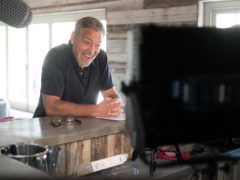 George Clooney looks excited to be pitching his legendary idea to family bakers in new advert that celebrates Warburtons dedication to baking the best quality (Warburtons/PA)