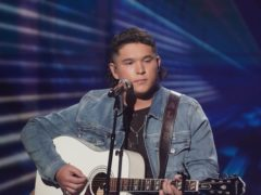 American Idol finalist Caleb Kennedy has left the talent show after footage emerged of him sitting next to someone wearing a white hood (ABC/Eric McCandless)