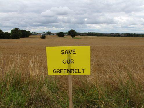 Poster at Florida Farm, Haydock, Merseyside, where green belt land was built over (Pat Hurst/PA)