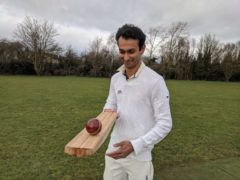 Dr Darshil Shah with the prototype bamboo cricket bat. (Cambridge University/ PA)