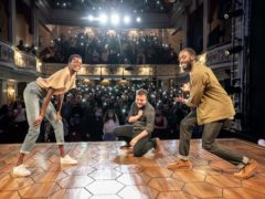 Sheila Atim as Marianne, Ivanno Jeremiah as Roland, and director Michael Longhurst with the audience making Constellations on their phones at the curtain call (Marc Brenner/PA)