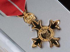 An OBE (Johnny Green/PA)