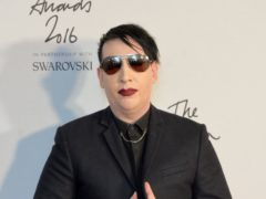 Marilyn Manson will turn himself in to authorities in Los Angeles over an alleged spitting incident in New Hampshire, police said (Matt Crossick/PA)