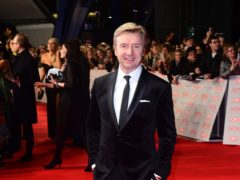 Christopher Dean was revealed as Beagle on The Masked Dancer (Ian West/PA)