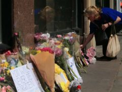 Flowers are left in Manchester, ahead of the National Service of Commemoration (Peter Byrne/PA)