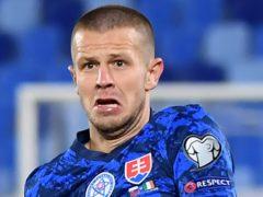 Slovakia defender Denis Vavro (right) has tested positive for coronavirus (Martin Baumann/PA)