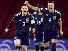 Liam Cooper, right, aims to be celebrating a famous Scotland win (Andrew Milligan/PA)
